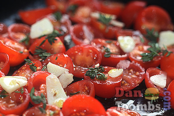 roasting tomatoes with garlic and herbs.