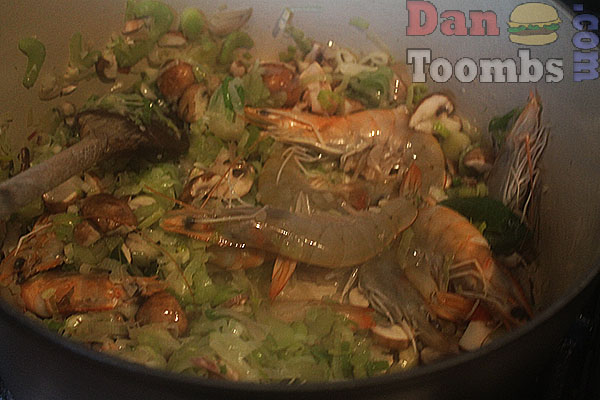 Making seafood stew Normandy style