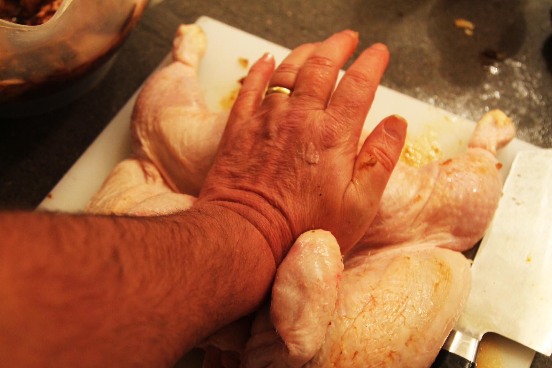 Preparing chicken for Thai gai yang