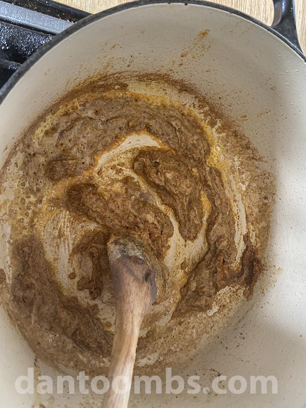 Frying the yellow curry paste