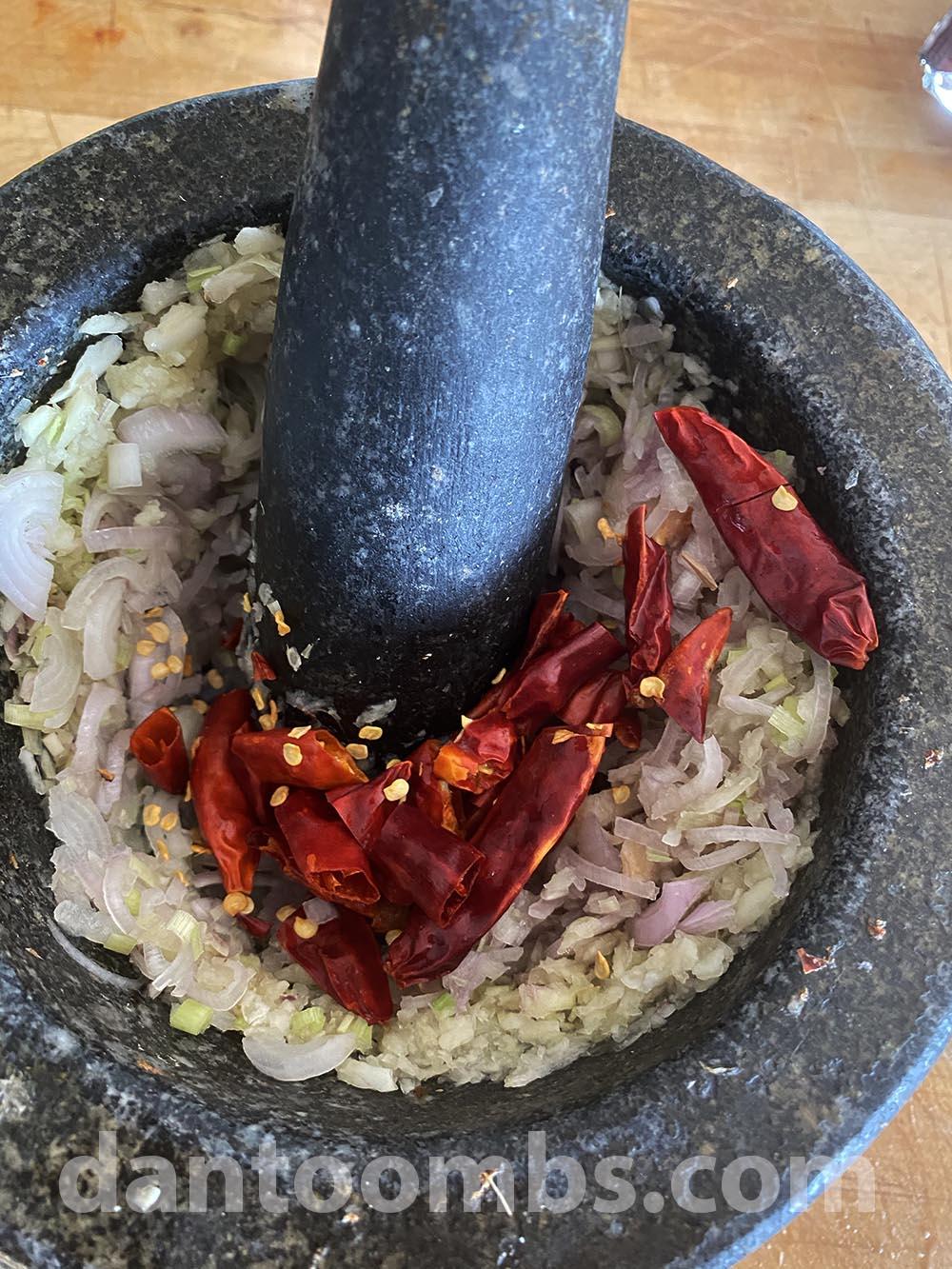 Pounding chillies