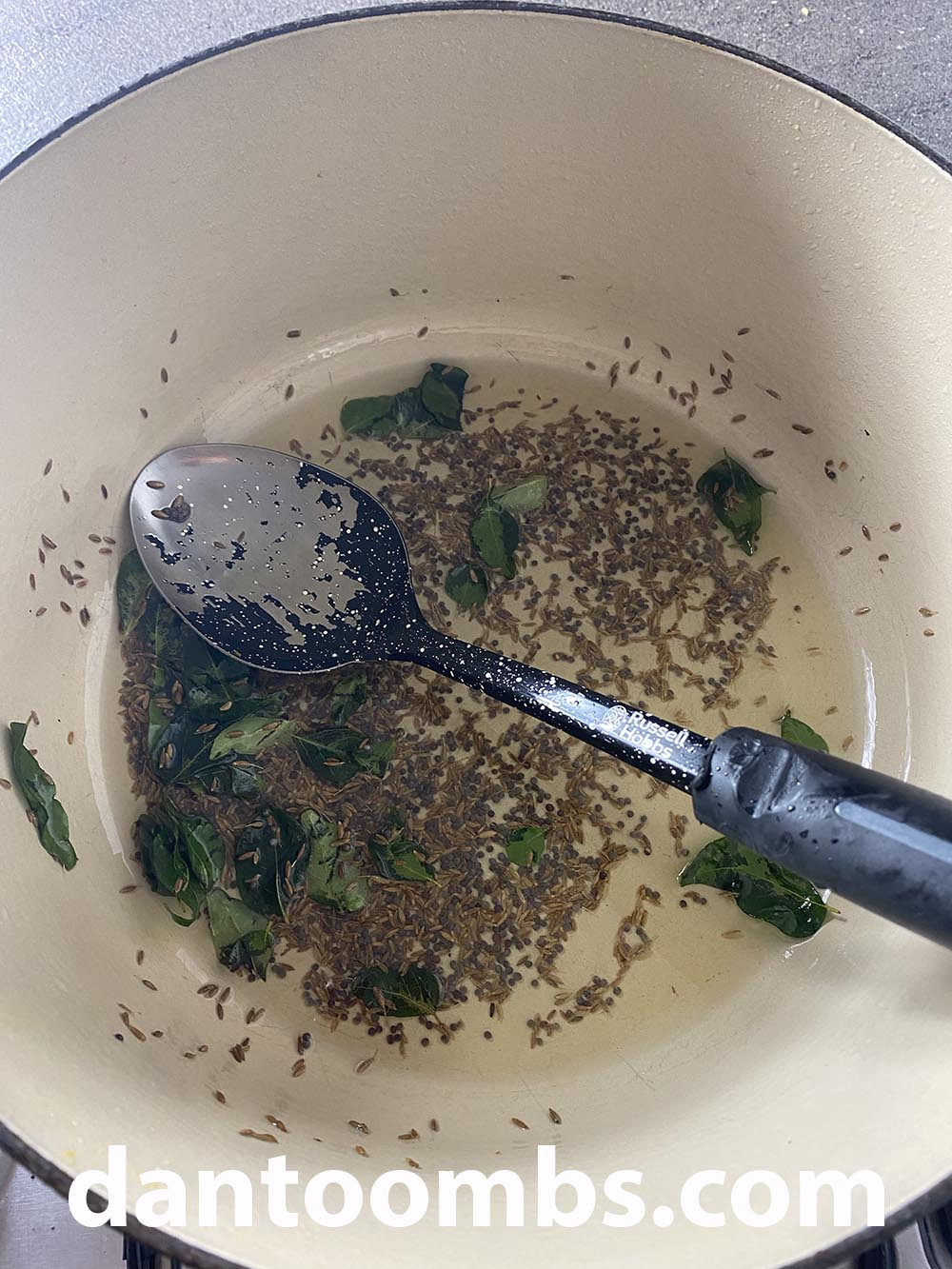 Heating curry leaves and spices